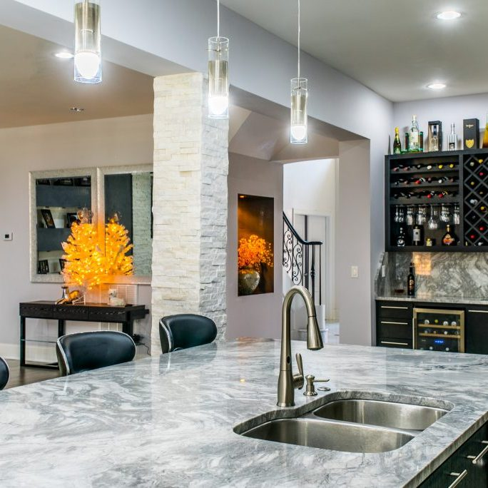 Marble kitchen island bar renovation by East Coast Granite & Marble