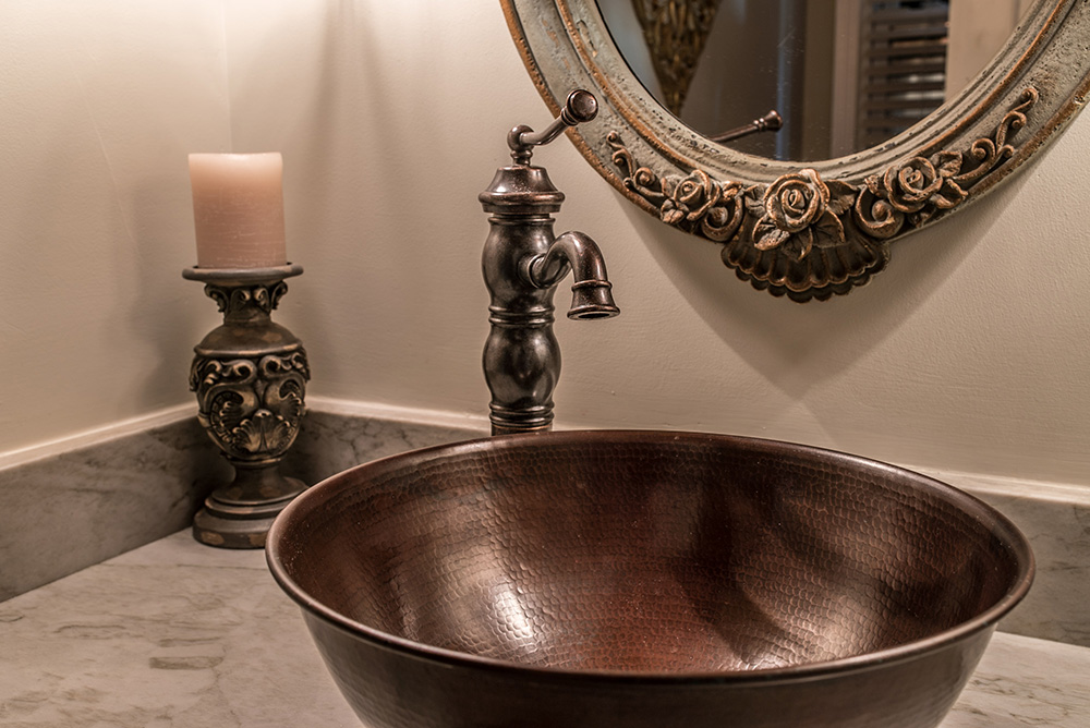 Sea Pearl quartzite vanity with copper vessel