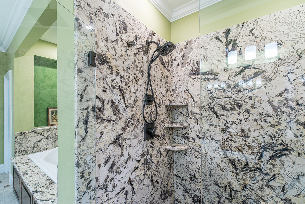 Delicatus Granite Shower Walls