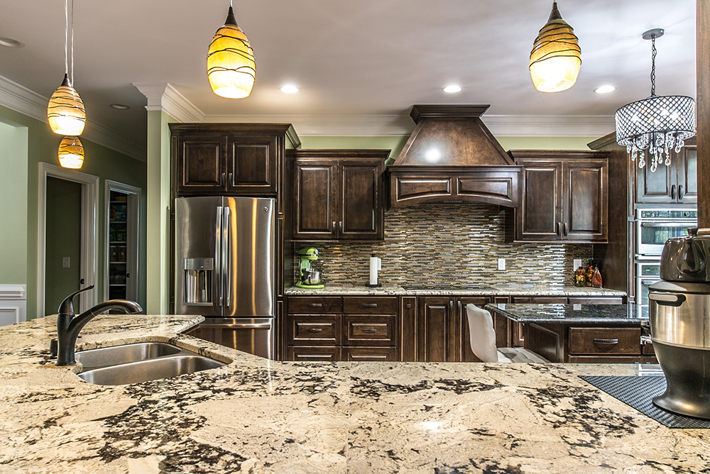 delicatus white granite countertops and muted brown and stainless tile backsplash accented with stainless steel appliances - White Granite Kitchen