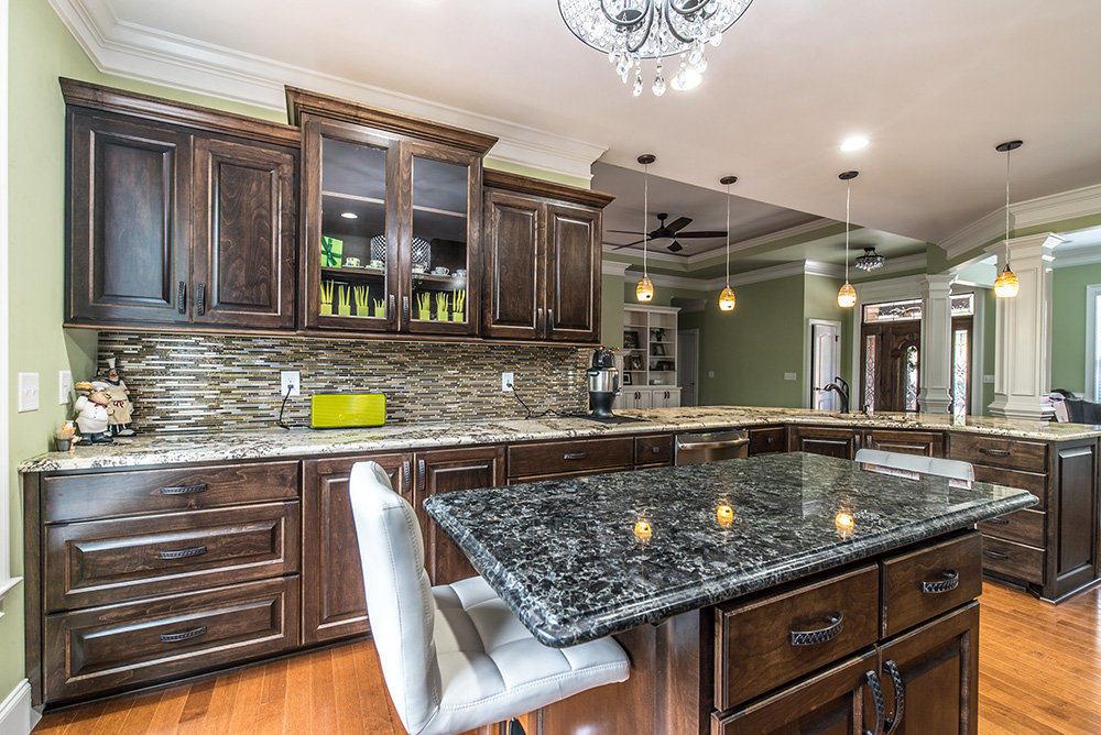 delicatus white granite kitchen countertops contrasted with a blue eyes granite island - Granite Kitchen Countertops