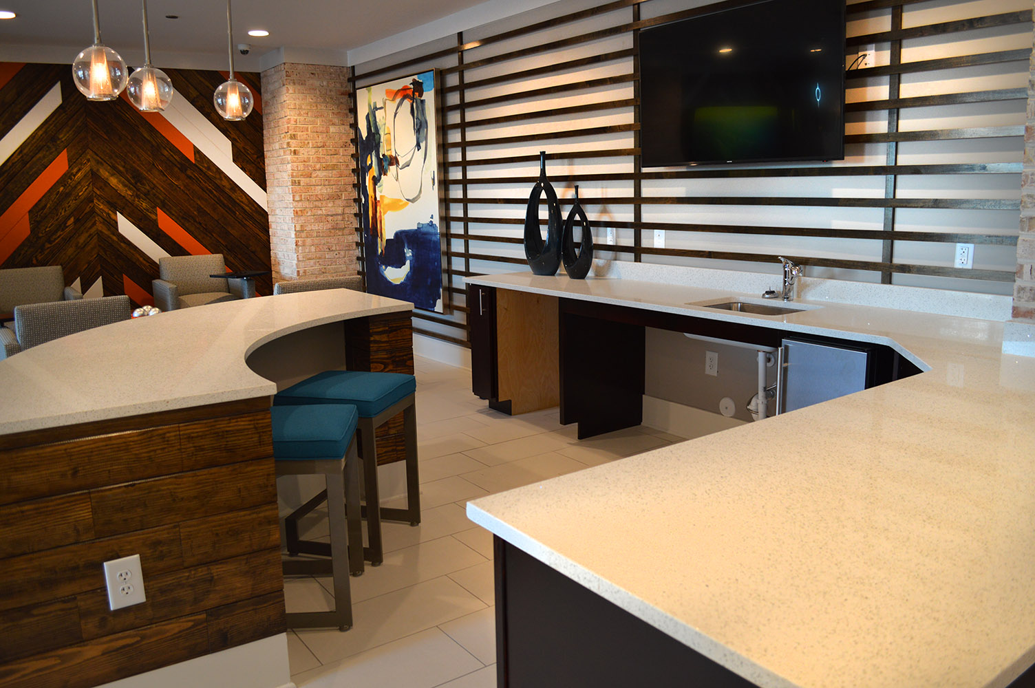 Link apartments has a plush commons area that features beautiful White quartz countertops bringing an airiness to the area