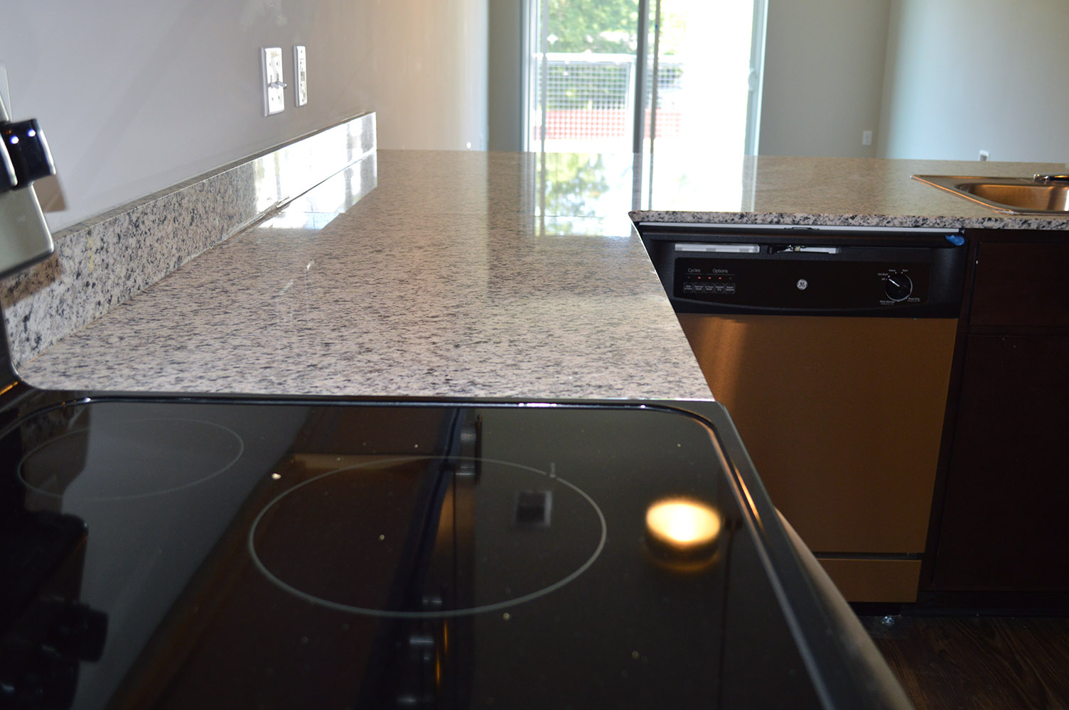 White Granite Countertops Add A Light And Airy Feel